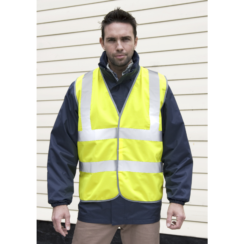 Photo of brown boy with reflective vest of yellow fluoride color to personalize in marcate.net