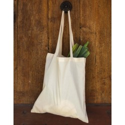 Beige or natural colored organic tote bag hanging from wooden bottom handles