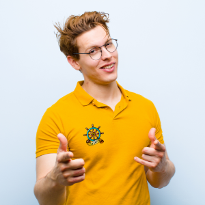 photo of boy with a yellow polo printed with a drawing